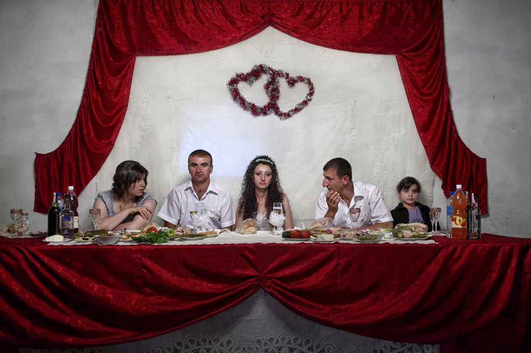 Картинки по запросу Photograph by Anastasia Taylor-Lind @anastasiatl | Maria Arustamyan is christened on her first birthday at Ghazanchetsots Church, Shushi, Nagorno-Karabakh Republic, July 19, 2011. Her parents, Anush and Grigory, pictured with Maria's godparents and grandmother, received a wedding and first baby payment of approximately 765 euros as part of the government's Birth Encouragement Program, an initiative that hoped to spark a baby boom there. Nagorno-Karabakh, a de facto independent republic, is internationally recognized as a part of Azerbaijan.